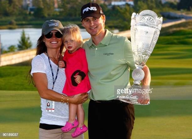 Heath Slocum poses with the championship trophy along with his wife Victoria and daughter Stella after winning The Barclays on August 30, 2009 at...