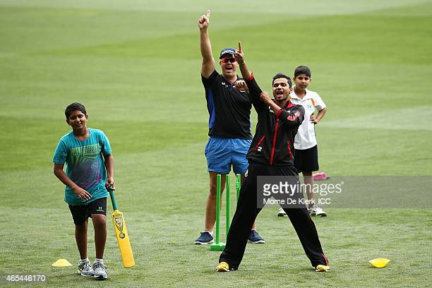 Heath Streak and Mashrafe Bin Mortaza of Bangladesh reacts during the ICC Charity Coaching Clinic at the Adelaide Oval on March 7 2015 in Adelaide...