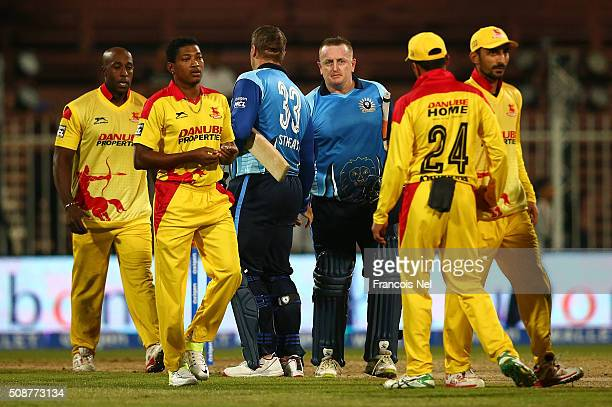 Heath Streak and Scott Styris of Leo Lions shake hands with their opponents after winning the match during the Oxigen Masters Champions League match...
