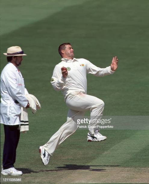 Heath Streak bowing for Zimbabwe during the 1st Test match between England and Zimbabwe at Lord's Cricket Ground, London, 20th May 2000. The umpire...