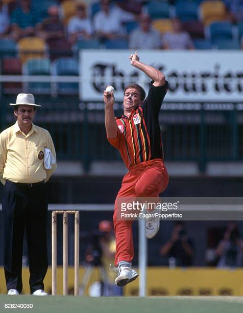 Heath Streak bowling for Zimbabwe during the Benson and Hedges World Series Cup match between England and Zimbabwe at Brisbane, Australia, 7th...
