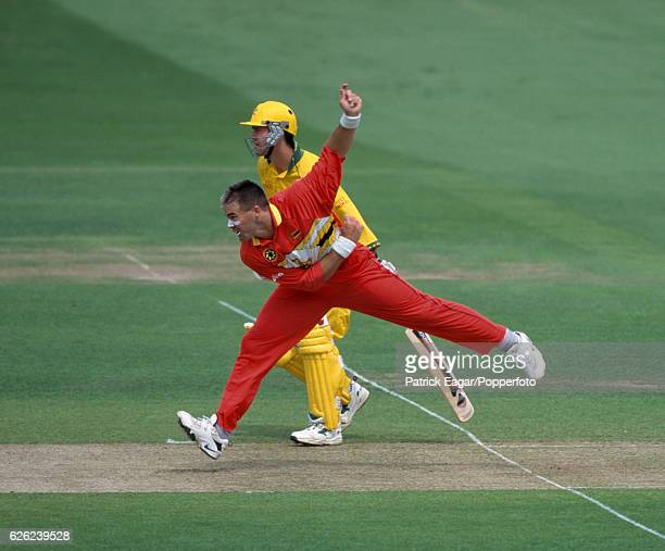 Heath Streak bowling for Zimbabwe watched by Ricky Ponting of Australia during the World Cup Super Six match between Australia and Zimbabwe at Lord's...