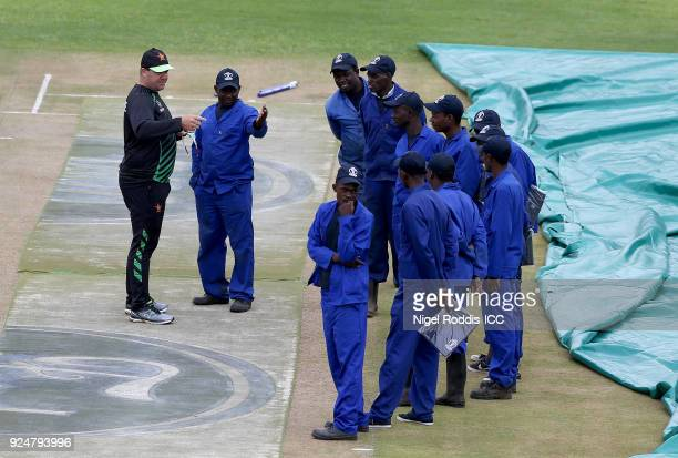 Heath Streak Head coach of Zimbabwe inspects the wicket with groundsmen ahead of the ICC Cricket World Cup Qualifier Warm Up match between Zimbabwe...