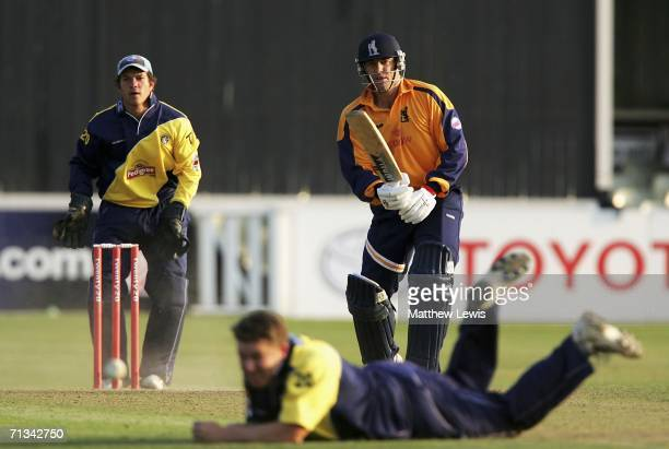 Heath Streak of Warwickshire looks on as he plays the ball past Martyn Ball of Gloucestershire looks on during the Twenty20 match between...