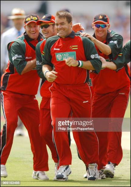 Heath Streak of Zimbabwe is congratulated after getting the wicket of England batsman Marcus Trescothick during the 1st NatWest Series One Day...
