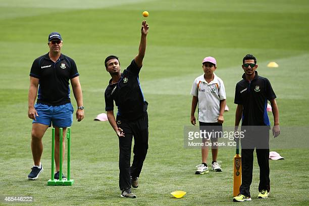 Heath Streak, Shakib Al Hasan, Nasir Hossain of Bangladesh take part during the ICC Charity Coaching Clinic at the Adelaide Oval on March 7, 2015 in...