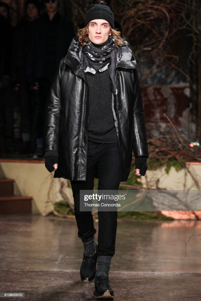 J. J. Heath walks the runway wearing John Varvatos Fall/Winter 2018 with makeup by Chika Chan for Make-Up Pro and Hair by Yannik D'Is for Cultler/Redken at the Angel Orensanz Foundation on January 26, 2018 in New York City.