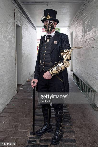 Heath Waller poses for a picture dressed in a suit all in Steam Punk style during the Whitby Goth Weekend on April 27 2014 in Whitby England