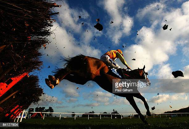Heathcliff ridden by Oliver Greenall clears the final hurdle on its way to winning the Coralcouk Handicap Hurdle race prior to the Welsh National...