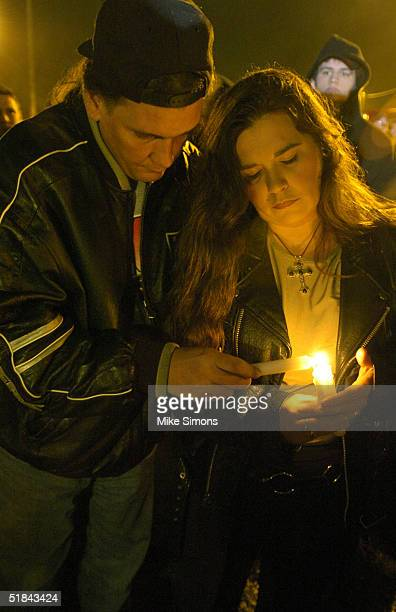 Heather and David Ansley light candles at an impromptu vigil outside of the Alrosa Villa Club on December 9, 2004 in Columbus, Ohio. According to...