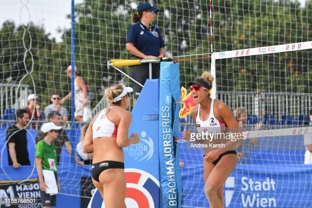 Heather Bansley and Brandie Wilkerson of Canada celebrate a point during the pool play match between Heather Bansley and Brandie Wilkerson of Canada...