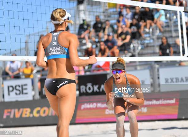 Heather Bansley and Brandie Wilkerson of Canada celebrate after winning a point against Melissa Humana-Paredes and Sarah Pavan of Canada during the...