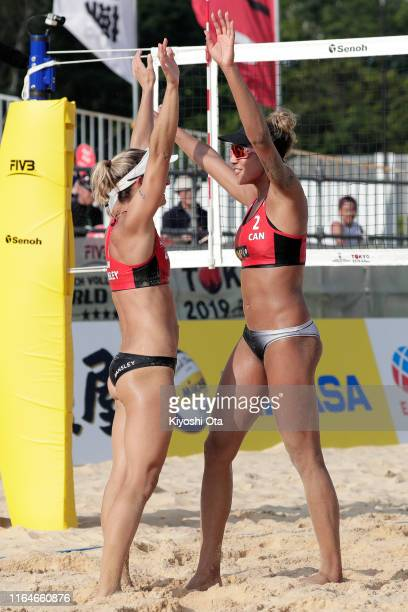 Heather Bansley and Brandie Wilkerson of Canada celebrate after winning the Women's bronze medal match against Julia Sude and Karla Borger of Germany...