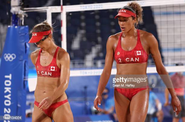 Heather Bansley and Brandie Wilkerson of Team Canada react against Team Latvia during the Women's Quarterfinal beach volleyball on day eleven of the...