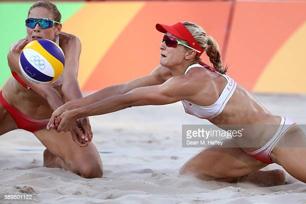 Heather Bansley of Canada and teammate Sarah Pavan dive for the ball during a Women's Quarterfinal match between Canada and Germany on Day 9 of the...