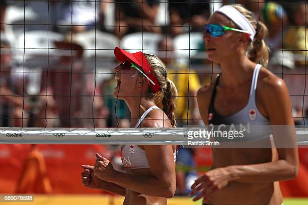 Heather Bansley of Canada celebrates after winning a Women's Round of 16 match while Kristina Valjas of Canada looks on during Day 8 of the Rio 2016...