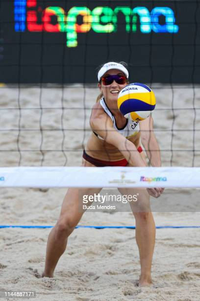 Heather Bansley of Canada in action during the Women's Semifinals match against Melissa Humana-Paredes and Sarah Pavann of Canada during the FIVB...