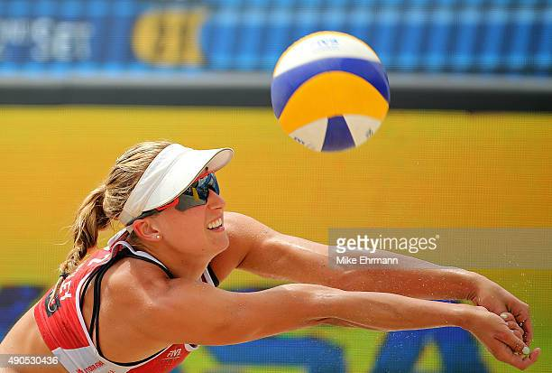 Heather Bansley of Canada plays a shot during a match against Emily Day and Jennifer Kessy of the United States during the 2015 Swatch FIVB World...