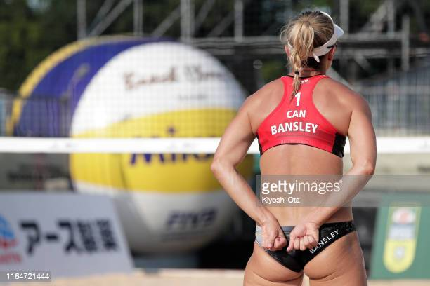 Heather Bansley of Canada signals her teammate Brandie Wilkerson in the Women's bronze medal match against Karla Borger and Julia Sude of Germany on...