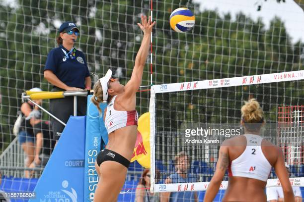 Heather Bansley of Canada spikes during the pool play match between Heather Bansley and Brandie Wilkerson of Canada and Barbora Hermannova and...