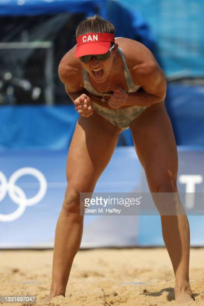 Heather Bansley of Team Canada celebrates after a play against Team United States during the Women's Round of 16 beach volleyball on day nine of the...