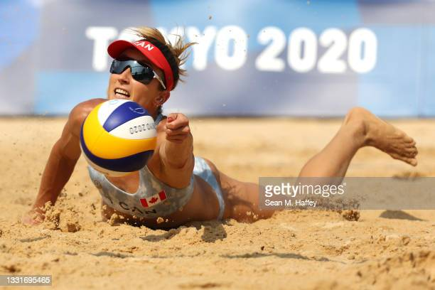Heather Bansley of Team Canada dives for the ball against Team United States during the Women's Round of 16 beach volleyball on day nine of the Tokyo...