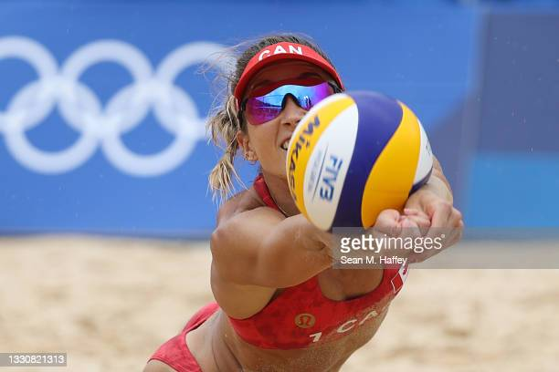 Heather Bansley of Team Canada dives to return the ball against Team Argentina during the Women's Preliminary - Pool C beach volleyball on day four...