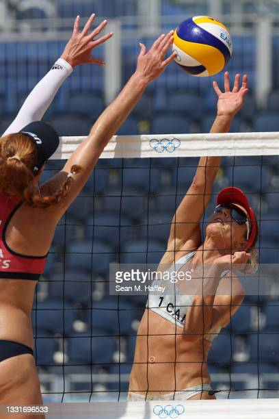 Heather Bansley of Team Canada strikes against Team United States during the Women's Round of 16 beach volleyball on day nine of the Tokyo 2020...