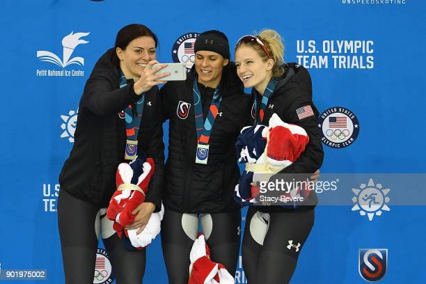 Heather Bergsma Brittany Bowe and Mia Manganello pose for a selfie while standing on the podium after competing in the Ladies 1500 meter eventduring...