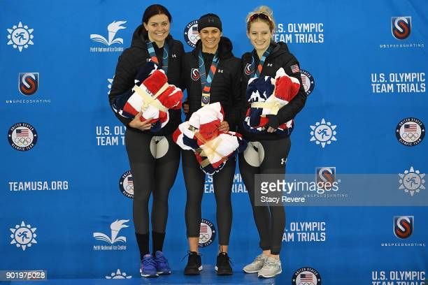 Heather Bergsma Brittany Bowe and Mia Manganello stand on the podium after competing in the Ladies 1500 meter eventduring the Long Track Speed...