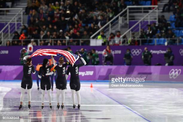 Heather Bergsma, Brittany Bowe, Mia Manganello and Carlijn Schoutens of the United States celebrate after winning the bronze medal in the Speed...