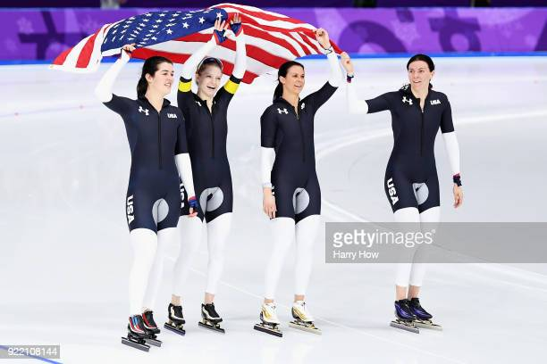 Heather Bergsma Brittany Bowe Mia Manganello and Carlijn Schoutens of the United States celebrate after winning the bronze medal in the Speed Skating...