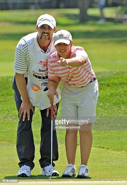 Heather Bowie and her caddy Jeremy Young line up a putt on the 16th hole during the final round of the Jamie Farr Owens Corning Classic July 10 2005...