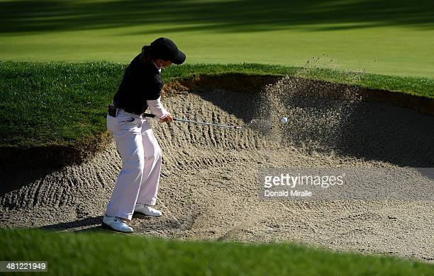 Heather Bowie Young hits out of the 10 green bunker during the second round of the KIA Classic at the Park Hyatt Aviara Resort on March 28 2014 in...