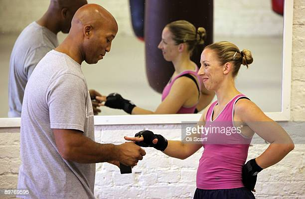 Heather Brooks has her fingers taped prior to boxing in Miguel's Gym in Brixton on August 13, 2009 in London, England. The International Olympic...