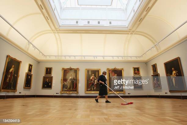 Heather Bundy gallery worker sweeps the floor in the Ramsay room at the Scottish National Portrait Gallery, following a £17.6million restoration...