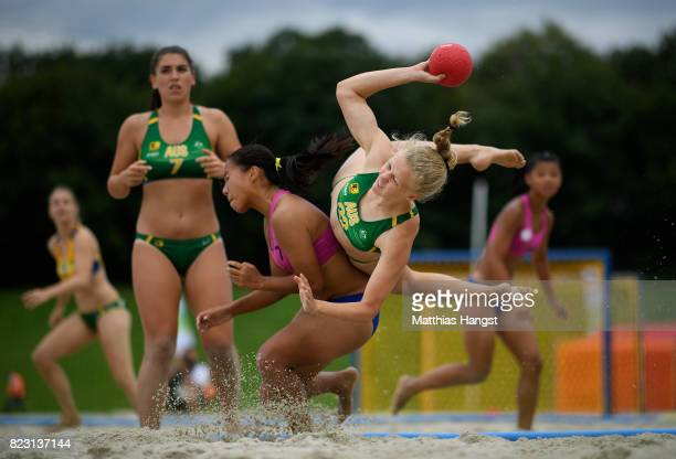Heather Cooper of Australia is challenged by NienEn Hsieh of Chinese Taipei during the Beach Handball Women's Group B match between Australia and...