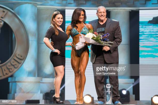 Heather Dees is awarded sixth place in Figure International as part of the Arnold Sports Festival on March 3 at the Greater Columbus Convention...