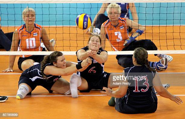 Heather Erickson and Brenda Maymon of USA go for the ball during the Sitting Volleyball match between the USA and the Netherlands at China...