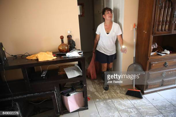 Heather FaustDworniczak begins the process of salvaging what she can from her home of seven years that was flooded and badly damaged by hurricane...
