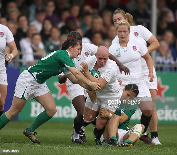 Heather Fisher of England gets tackled by Tania Rosser and Helen Brosan of Ireland during the Women's Rugby World Cup 2010 Pool B Match between...