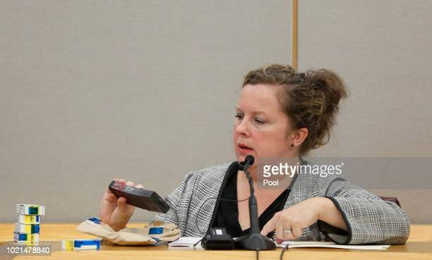 Heather Francis fire arm and tool mark examiner with the Dallas County crime lab holds the magazine from Roy Oliver's rifle during her testimony on...