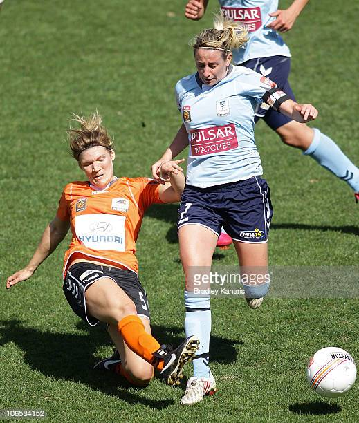 Heather Garriock of Sydney and Brooke Spence of the Roar challenge for the ball during the round one W-League match between the Brisbane Roar and...