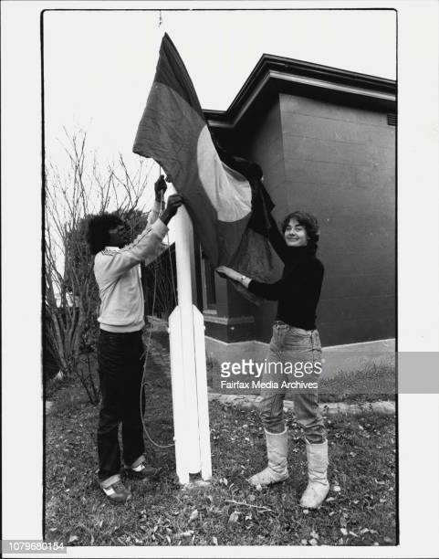 Heather Goodall at trany college in Mansfield St GlebeHeather Goodall and Allan Hines getting the knots out of the Aboriginal Flag at the front of...