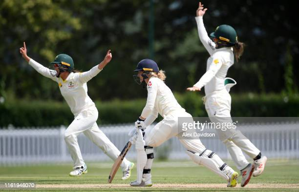 Heather Graham of Australia A and Molly Strano of Australia A celebrate the wicket of Sarah Taylor of England during Day Three of the International...