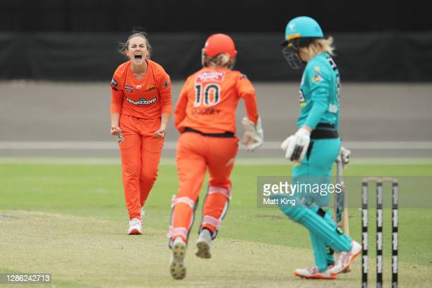 Heather Graham of the Scorchers celebrates taking the wicket of Georgia Redmayne of the Heat during the Women's Big Bash League WBBL match between...