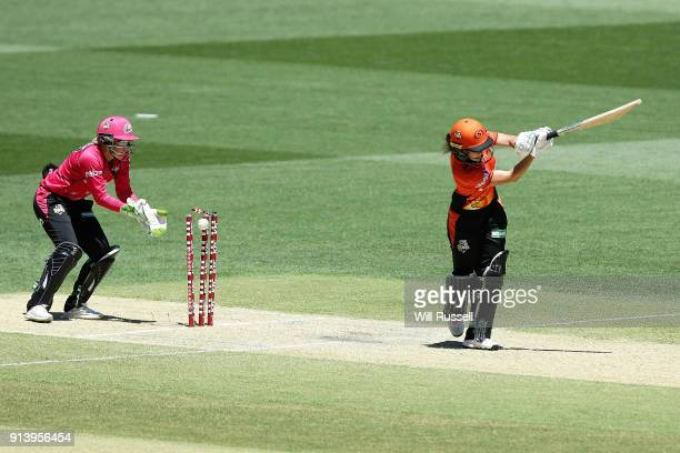 Heather Graham of the Scorchers is bowled out by Sarah Coyte of the Sixers during the Women's Big Bash League final match between the Sydney Sixers...