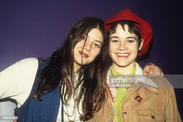 Heather Grody and Leisha Hailey of alternative rock group The Murmurs smile while at Club USA in New York 1993
