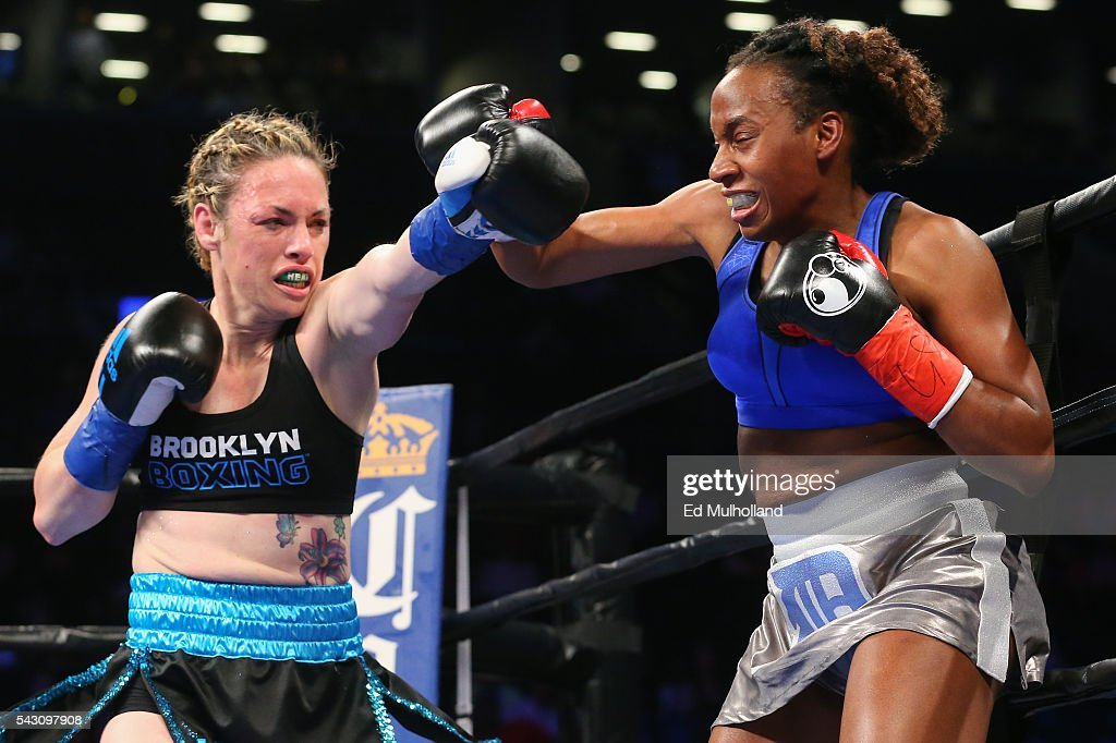 Heather Hardy (left) and Kirstie Simmons (right) trade punches during their bout at the Barclays Center on June 25, 2016 in the Brooklyn borough of New York City.
