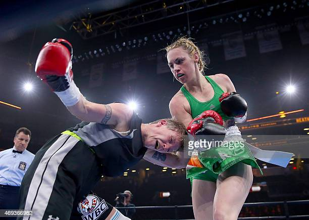 Heather Hardy and Renata Domsodi exchanges punches during the Premier Boxing Champions Junior Featherweight bout at Barclays Center on April 11, 2015...